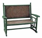 This porch settee was made at the turn of the 20th century. The 47-inch-wide piece has old green paint and its original wicker back and seat. It sold for $550 at a James Julia auction in Fairfield, Maine, this fall.