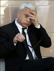 Actor Robert Blake awaits word on the jury's verdict in the civil wrongful death case against him Friday outside the Los Angeles Superior courthouse in Burbank, Calif. He was found liable in the death of his wife, Bonny Lee Bakley.