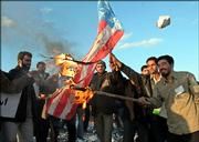 Iranian students burn a U.S. flag during a demonstration to support Iran's nuclear program Friday in front of the Natanz Uranium Enrichment Facility, some 200 miles south of the capital, Tehran, Iran.