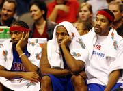 Detroit's Richard Hamilton, left, Chauncey Billups, center, and Rasheed Wallace watch the final seconds of their game against Dallas. The Mavericks won, 119-82, Saturday in Dallas, handing the Pistons their first loss of the season.