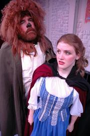 "Knute Pintenger as the Beast and Kendra Verhage as Belle rehearse a scene from Theatre Lawrence&squot;s production of ""Beauty and the Beast"" in 2005."