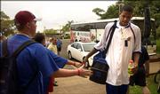 Kansas University center C.J. Giles shakes hands with Overland Park youngsters Ryan Robertson, front, 17, and his younger brother Tyler, 15, upon enterring the Lahaina Civic Center in Maui before the start of the Jayhawks' first-round game against Arizona.