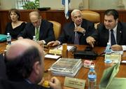 Israeli Prime Minister Ariel Sharon, second from right, looks around the cabinet room as he adjusts his tie during the weekly cabinet meeting Sunday at his Jerusalem office. Sharon reportedly announced that he will leave the Likud Party to form a new party for the spring elections.