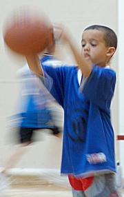 Ten Tigers player Anton Bratton pulls in a rebound in his game against the Heat Saturday at the East Lawrence Center.