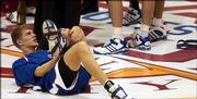 Kansas guard Micah Downs stretches prior to Tuesday's game against Arkansas.