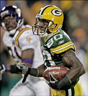Green Bay's Donald Driver breaks away for a 53-yard touchdown reception against Minnesota. Driver caught two TD passes, but the Vikings beat the Packers, 20-17, Monday night in Green Bay, Wis.