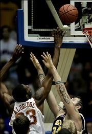 Texas forward Lamarcus Aldridge, left, shoots the game-winning basket against West Virginia's Kevin Pittsnogle. The Longhorns won, 76-75, Monday in Kansas City, Mo., in the semifinals of the Guardians Classic.