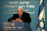 Israeli Prime Minister Ariel Sharon speaks during a press conference Monday at his Jerusalem office. Sharon broke away from his hardline Likud Party to form a new centrist party.