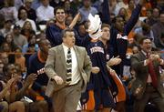 Coach Pat Flannery and the bucknell bench celebrate taking the lead against Syracuse. The Bison beat the Orange, 74-69, Tuesday in Syracuse, N.Y.