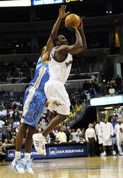 Washington Wizards' Gilbert Arenas, right, shoots against the Denver Nuggets' Marcus Camby, who knocked the ball away during the closing seconds of the fourth quarter Tuesday. The Nuggets won, 108-105.