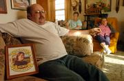 Don Bell, of Tonganoxie, sits in the front room of his home with his mother and her sister as he talks about the death of his wife, Robin Bell, who was murdered in Bonner Springs earlier this month. Don Bell said Tuesday that he has been so consumed by the investigation into his wife's killing that he has not had time to properly grieve.