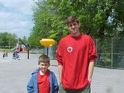 Third-Grader Bryce Ridgeway stands beside Christian Moody, a Kansas University basketball player, on the playground at Pinckney School. Kitsy Gray, a teacher at Pinckney, submitted the picture.