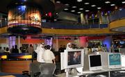 Media representatives look around Al-Jazeera's new news room in Doha, Qatar, in this June 15 file photo. The Daily Mirror reported Tuesday that a government memo suggested that Prime Minister Tony Blair persuaded President Bush not to bomb the Arab satellite station Al-Jazeera.