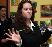 Tina Schreffler speaks about her experience with yo-yo waterballs during a news conference held to talk about the U.S. Public Interest Research Group's latest holiday-time survey on dangerous toys Tuesday in Trenton, N.J.