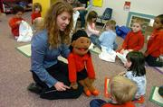 "Tracy Williams, with the GaDuGi SafeCenter in Lawrence, uses ""Rosie"" the puppet Tuesday to teach preschoolers to say ""no"" if an adult tries to touch them inappropriately. The 15-session course has other safety lessons, too, such as fire and gun safety."