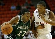 Binghamton guard Troy Hailey drives against Oklahoma guard Michael Neal. The No. 5 Sooners knocked off the Bearcats, 88-60, Wednesday night in a nonconference matchup at Norman, Okla..