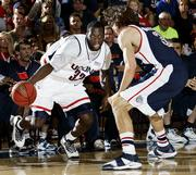 Connecticut's Denham Brown drives on Gonzaga's Adam Morrison during the championship game of the Maui Invitational in Lahaina, Hawaii.