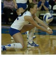 Kansas University's Dani Wittman bumps in the Jayhawks' 3-1 loss to Missouri. KU fell Wednesday at Horesji Center. Story on page 3C.