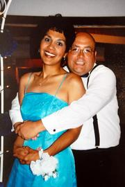 Before: This submitted wedding photo shows Sgt. James Anguiano, with the KU Public Safety Office, before he lost 75 pounds in a diet program that he has participated in with other officers on the force. Anguiano's wife, Linda, is on his left.