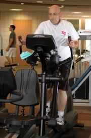After: This photo shows the lighter, fitter Anguiano working out Tuesday at KU's Student Recreation Center.