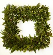Square wreaths are hot this holiday season. California floral designer Jerry Bolduan created this one from bay laurel, fruited olive and rosemary for Cherie Yvette Flowers in Lawrence.