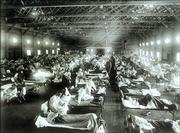 In this 1918 photograph provided by the National Museum of Health and Medicine, Armed Forces Institute of Pathology, Spanish flu victims crowd into an emergency hospital at Camp Funston, a subdivision of Fort Riley. Most historical accounts say the flu, which killed about 600,000 Americans and millions worldwide, originated in Kansas.