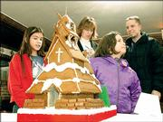 From left, Helen Hawkins, Jane Dennington, Aerial Berry and Christopher Julian admire Julian's gingerbread house in the 2004 Gingerbread House Auction. The event is a fundraiser for Big Brothers/Big Sisters.