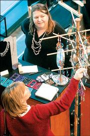 Michelle Babcock assists a customer at the 2004 Holiday Art Fair. This year's event will be Dec. 3.