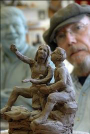 "A foundation dedicated to promoting the work of ""Black Elk Speaks"" author John Neihardt has selected Lawrence sculptor Jim Brothers to create a statue in honor of the author and his subject. Brothers is shown with a model of the proposed sculpture."