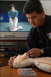 Lt. Jim Saladin demonstrates the DVD kit that teaches a CPR course for the home. The kit includes a DVD and a small dummy that allows you to teach yourself CPR.