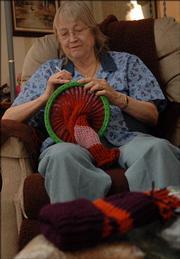 Charlene Kornbrust knits stocking caps for those in need.