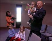The Rev. Shaun LePage, shown at right with his son Josiah, 2, and his wife, Beth, holding their daughter Lydia, 7 months, and daughters Hanna, 6, and Abigail, 4, have joined Lawrence's Community Bible Church. LePage has replaced the Rev. Chuck Thomas, the church's founder, as pastor.