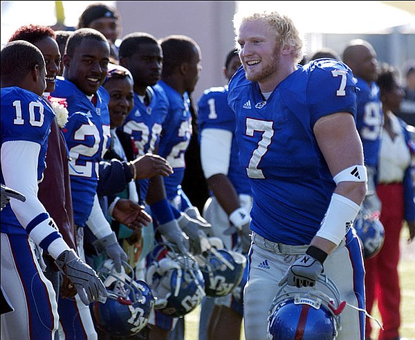 KU's Nick Reid makes his way down the line of KU seniors during senior day introductions Saturday at Memorial Stadium.