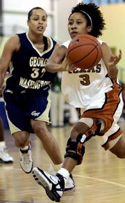Ttexas guard Carla Cortijo (3) moves the ball past George Washington's Sarah Jo Lawrence. The Longhorns won, 59-54, Saturday in Freeport, Bahamas.