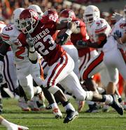 Oklahoma's Allen Patrick (23) runs for a touchdown against Oklahoma State. The Sooners won big, 42-14, Saturday in Norman, Okla., for their third straight victory in the Bedlam rivalry.