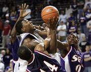 Kansas State's David Hoskins, center, is tangled up with three Stephen F. Austin defenders in the first half. The Wildcats won, 71-54, Saturday night in Manhattan.