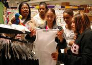 Delta Sigma Theta members, from left, Jennifer King, Danica Moore, Yana Delkhah, Marie Hampton and Ragan Foreman, browse Kansas University gear at the Jayhawk Bookstore. The sorority raises money for different causes, including an upcoming project to benefit AIDS research.