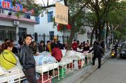 Hospital sickbeds were moved to the roadside Saturday in case of aftershocks in Ruichang City, China. An earthquake of magnitude-5.7 rattled parts of central China on Saturday morning, killing at least 15 people and injuring 450, the government said.