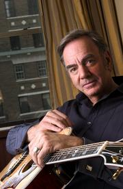 "Singer Neil Diamond, 64, has returned with ""12 Songs,"" a back-to-basics disc produced by musical guru Rick Rubin. His work debuted at a personal-best No. 4 on the Billboard album chart."