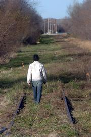A city committee has recommended that an abandoned rail line in East Lawrence should become a 10-foot wide hike/bike trail surrounded by native plants and grasses.  A hiker recently followed the tracks north from 23rd Street.