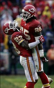 Kansas City Chiefs cornerback Patrick Surtain (23) celebrates with safety Greg Wesley (25) after Wesley pulled down his third interception of the game during the fourth quarter of the Chiefs' 26-16 victory over New England. K.C. beat the Patriots Sunday at Arrowhead Stadium in Kansas City, Mo.