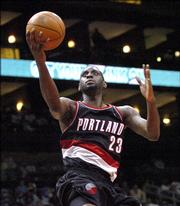 Portland Trail Blazers forward Darius Miles goes to the net against the Atlanta Hawks during the third quarter. The Trail Blazers won, 77-75, on a basket by Miles with 1.3 seconds left in the game Sunday in Atlanta.