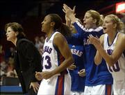 Kansas University's bench erupts after taking the lead against Northeastern during the closing moments of the KU's 70-65 victory. The Jayhawks won Sunday in Allen Fieldhouse.