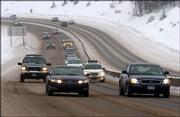 Cars travel over Vail Pass during a lingering winter storm in the Colorado mountains in this 2005 photo near Vail, Colo.
