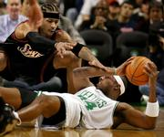 Boston's Paul Pierce, bottom, looks for an opening to pass as Philadelphia's Allen Iverson tries to block him. The Celtics defeated the 76ers, 110-103, Wednesday night in Boston.