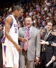 Kansas University coach Bill Self, center, and assistant Tim Jankovich, right, welcome C.J. Giles to the bench during last year's game against Nevada. Giles had five points and eight rebounds, helping the Jayhawks beat the Wolf Pack, 85-52, on Nov. 29, 2004, in Allen Fieldhouse.