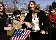 Brandy Sacco, center, is helped by friends and family after thanking supporters who held a counter-protest to the Rev. Fred Phelps' protest of the funeral service of her husband, Sgt. Dominic Sacco, on Friday in Topeka. Sacco died in combat Nov. 20 while serving in Iraq.