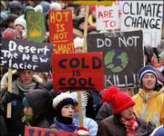 Demonstrators carry signs during a protest against global warming Saturday in Montreal. The demonstration coincided with the U.N. Climate Change Conference in Montreal, where officials are reviewing the Kyoto Protocol on lowering greenhouse gas emissions.
