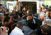 Iraqi mourners on Saturday carry the body of one of three slain men whose bodies were found near Fallujah, Iraq, from an ambulance toward the hospital morgue in Baghdad, Iraq.