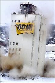 The bottom portion of the Zip Feed Mill tower in Sioux Falls, S.D., collapses Saturday during an attempted demolition of the building. After collapsing about 40 to 50 feet, the building remained standing, leaning to the east. The event was used as a fundraiser for the Dakota chapter of the National Multiple Sclerosis  Society.